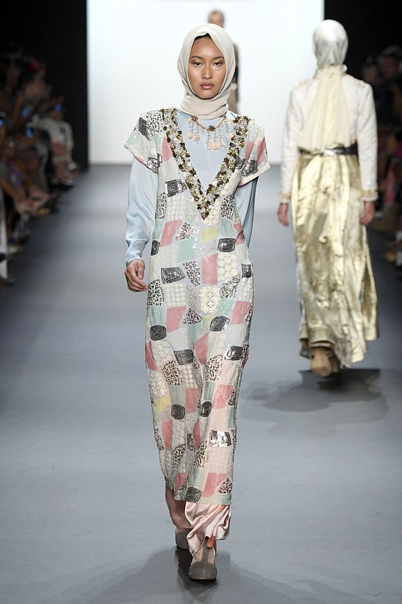 1ca6b1d2097 Anniesa Hasibuan was the first Muslim and the first Indonesian designer to  show the hijabs on. Spring summer ...