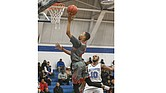 George Wythe High School's Darrell Purdie puts up a shot against L.C. Bird High School's Johquin Wiley during a game Jan. 4. The Wythe Bulldogs won the game and are now 7-3.