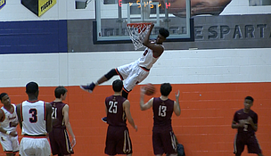 Romeoville forward Dontia Johnson dunks during his team's 51-45 win over St. Ignatius on Saturday, January 21, 2017.