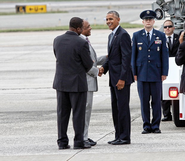 President Obama is greeted by Tyrone Nelson, chairman of the Henrico County Board of Supervisors, left, and Richmond Mayor Dwight C. Jones upon arrival at Richmond International Airport in September 2016. The president stopped in Richmond on his way to Fort Lee in Petersburg for a town hall with military families.