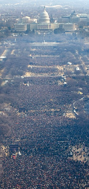 Left, nearly 2 million people crowd the National Mall for President Obama's inauguration Jan. 20, 2009, as the nation's 44th and first African-American president.