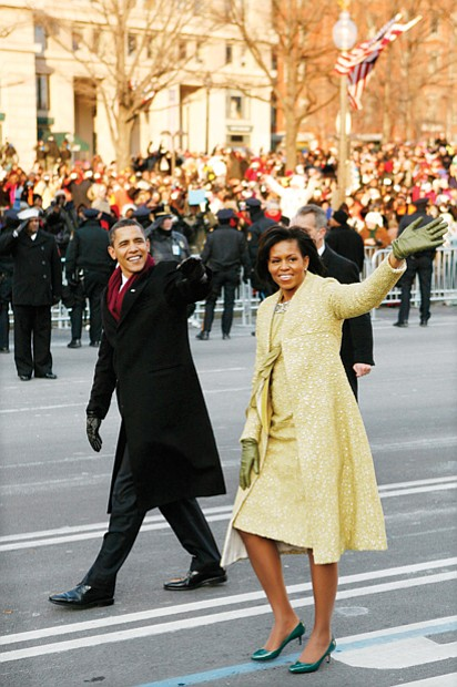 newly sworn-in President Obama and his wife walk down Pennsylvania Avenue to the cheers of the crowd during his Inaugural Parade in 2009.