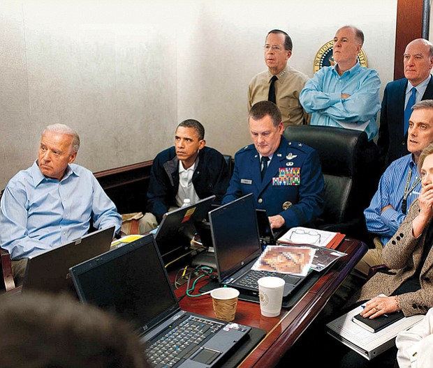 President Obama, cabinet members and staff watch inside the Situation Room as U.S. forces raid Osama bin Laden's compound in Pakistan, killing the terrorist leader in May 2011.