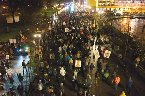 A myriad of community organizations and tens of thousands of individuals took to the streets in downtown Portland for a ...