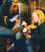 Volunteer medics apply milk to the eyes of a demonstrator to reduce his burning sensation after Portland Police used pepper spray to control crowds at a demonstration and march Friday evening hat followed the presidential inauguration of Donald Trump.