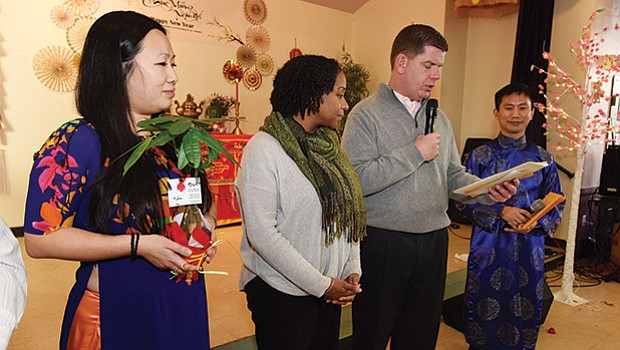Mayor Martin Walsh and City Councilor Andrea Campbell join Vietnamese community members at Viet Aid's Fields Corner office in celebration of Tet, Vietnamese Lunar New Year.