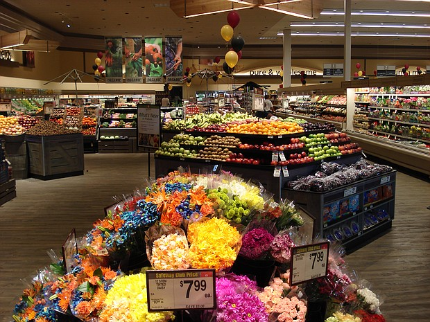 Grocery stores often place brightly colored flowers and produce at the entrance to attract your attention.