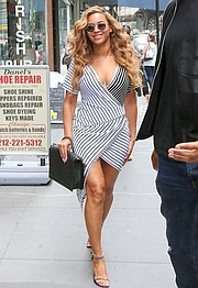 Beyonce steps out in a wrap dress.
