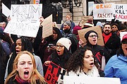 Protesters filled Copley Square plaza on Sunday to rebuke Trump's travel ban, which blocks entry to refugees and immigrants from predominantly Muslim countries.