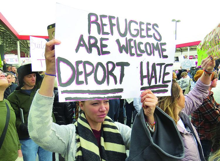 news trump immigration executive order muslim refugee syria iraq iran libya somalia sudan yemen sign