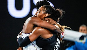 Serena Williams, right, hugged her sister, Venus Williams after their women's singles final