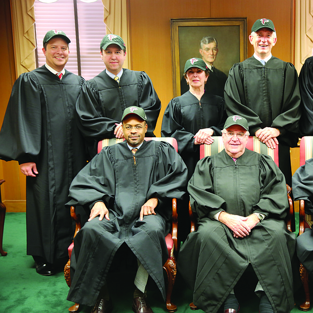"Georgia Supreme Court Justices, row left to right: Presiding Justice Harold Melton, Chief Justice P. Harris Hines, Justice Robert Benham. Back row left to right: Justice Nels Peterson, Justice Keith Blackwell, Justice Carol Hunstein, Justice David Nahmias, Justice Michael Boggs, Justice Britt Grant worn Falcons cap in a special Jan. 24 session. They entered the court to ""Rise Up"" and then rose together from their seats and cheered, ""GO FALCONS!"""