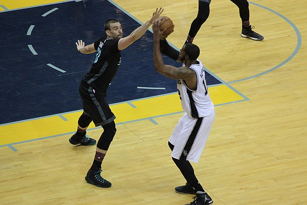 Marc Gasol defends against Spurs forward LaMarcus Aldridge. The Grizzlies held San Antonio to nine points in the fourth quarter and earned an 89-74 victory over their Southwest Division rivals.