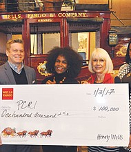 Maxine Fitzpatrick of Portland Community Reinvestment Initiatives (2nd from left) accepts a Wells Fargo Housing Foundation grant for the non-profit organization she leads to build 22 affordable homes for low income and displaced residents of north and northeast Portland. Also pictured (from left) are Wells Fargo executives Andrew Tweedie,  Tracy Curtis and Cobi Lewis.
