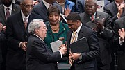 Rep. Cedric Richmond accepts the CBC chairman's gavel from the previous chairman, G.K. Butterfield (North Carolina District 1). (Photo via the Congressional Black Caucus Foundation)