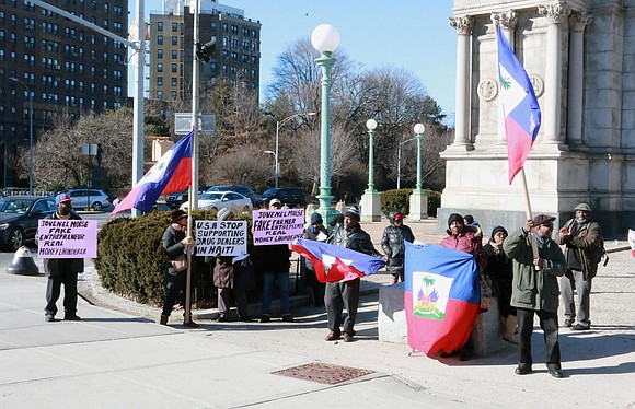 Saturday, Feb. 4, 2017, at Grand Army Plaza, KOMOKODA and a group of Haitians and their friends protested what they ...