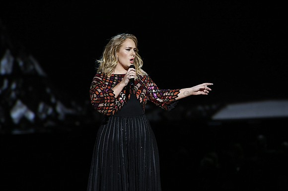 Adele really, really wanted to share her admiration for Beyoncé at the Grammy Awards and social media felt her on ...