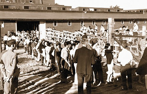 A historical photo shows the Portland Pacific International Livestock Expo Building in north Portland serving as a Japanese Assembly Center in 1942, the precursor to Japanese-Americans on the West Coast being incarcerated in what the federal government would call internment camps.
