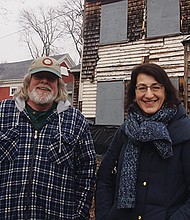 Restoration specialist Michael Mawn and Historic Boston Incorporated Executive Director Kathy Kottaridis tour the Fowler Clark Epstein farmhouse.