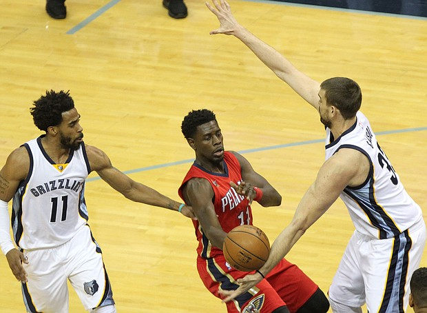 Mike Conley and Marc Gasol swarm on New Orleans Pelicans guard Jrue Holiday in the Grizzlies 91-95 loss on Wednesday night. GritGrindGrizz columnist Lee Eric Smith writes that Conley and Gasol must begin to co-dominate for the team to make a deep playoff run.