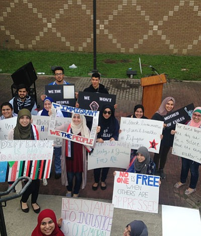 The Xavier University community walked about two miles around Drexel Drive leading the charge against President Donald Trump's ban on ...