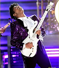 Bruno Mars pays tribute to Prince in a showstopping performance