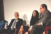 """Former U.S. Attorney General Eric Holder (in striped tie and suit), Harvard University scholar Dr. Elizabeth Hinton and Georgetown Professor Michael Eric Dyson at the """"Race: An American Cauldron"""" forum at the Jimmy Carter Presidential Library & Museum in Atlanta on January 15, 2017."""