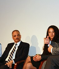 "Former U.S. Attorney General Eric Holder (in striped tie and suit), Harvard University scholar Dr. Elizabeth Hinton and Georgetown Professor Michael Eric Dyson at the ""Race: An American Cauldron"" forum at the Jimmy Carter Presidential Library & Museum in Atlanta on January 15, 2017."