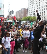 Youth listening to activist Viola Plummer