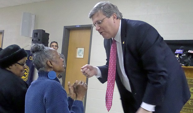 Mayor Jim Strickland speaks with Frayser resident Christine Grandberry prior to giving his State of the City address. (Photo: Brittney Gathen)