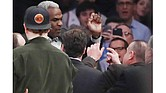 Basketball great Charles Oakley argues with a security guard before his arrest Feb. 8 at Madison Square Garden during an NBA game between the New York Knicks and the Los Angeles Clippers.
