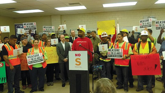 Wearing hardhats and waving homemade signs, a diverse collection of construction workers and affordable housing advocates gathered recently to protest ...