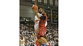 Virginia Commonwealth University's Moe Alie-Cox goes up to block a shot from Jack Gibbs of Davidson College during last Saturday's game at the Siegel Center. The Rams beat Davidson 74-60.