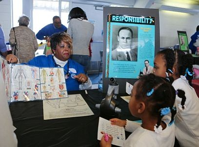 "Member of Zeta Phi Beta Sorority, Inc., at the ""Blood Plasma and Blood Banks"" - Dr. Charles Drew station. -- Photo by April A. Ward"