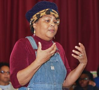 "Nationally renowned storyteller, Queen Nur led the crowd in an engagement song describing each of the Inventors highlighted at the Zeta Phil Beta Sorority, Inc Omicron Omicron Zeta Chapter & Williamstown Civic Group, Inc.'s ""Making a Way Out of No Way African American Storytelling and Inventors' Museum"" event. -- Photo by April A. Ward"