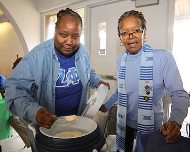 "Members of Zeta Phi Beta Sorority, Inc. at the ""Ice Cream Mold and Disher"" - Alfred Craile station.