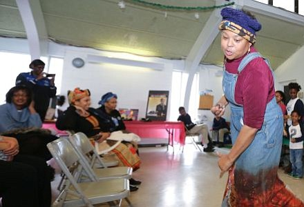 """Nationally renowned storyteller, Queen Nur led the crowd and volunteers in an interactive song about George Washington Carver's inventions in crop rotation and products from made peanuts, soybeans and sweet potatoes at the Zeta Phil Beta Sorority, Inc Omicron Omicron Zeta Chapter & Williamstown Civic Group, Inc.'s """"Making a Way Out of No Way African American Storytelling and Inventors' Museum"""" event.   -- Photo by April A. Ward"""