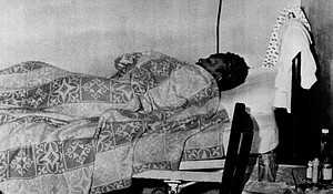 An unidentified woman rests at the Harris County Convalescent Ward at the old Jefferson Davis Hospital in Houston, Sept. 29, 1957.