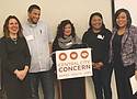 Multnomah County Chair Deborah Kafoury (left), Commissioner Loretta Smith (right), and Central City Concern staff members John Karp-Evans, Elissa Black and Freda Ceaser gather to announce a program called 'Flip the Script' to end the cycle of incarceration and homelessness for African-Americans in the justice system.