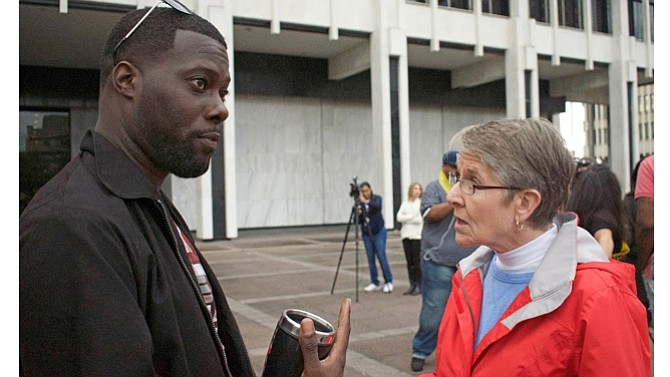 """Activist Keedran Franklin talks with Elaine Blanchard while """"weighing in"""" on the controversial list that requires some Memphians to be escorted by police when visiting City Hall. Franklin and Blanchard are both on the list.  (Photo: Karanja A. Ajanaku)"""
