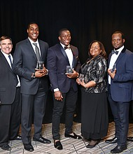 Global Chief Diversity Officer Ken Barrett, Global Manufacturing North American Vice President, Public Policy Dan Turton and Vice President, Operational Excellence Gerald Johnson congratulate Gm's 2017 classes of BEYA award recipients.