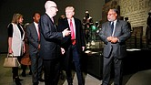 President Trump, center, talks with David Skorton, left, secretary of the Smithsonian Institution, and Lonnie G. Bunch III, founding director of the Smithsonian's National Museum of African American History and Culture in Washington, during Tuesday's tour.