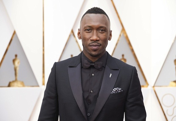 Mahershala Ali appears on the red carpet of the Academy Awards in Los Angeles before winning his first Oscar.
