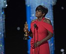 Viola Davis accepts the award for best supporting actress at the 89th Academy Awards.