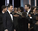 "Host Jimmy Kimmel took the stage to explain the mistake as the crew from ""La La Land"" exited and the news sunk in for the ""Moonlight"" cast and producers."