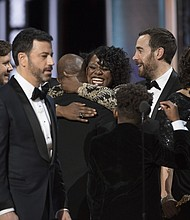 """Host Jimmy Kimmel took the stage to explain the mistake as the crew from """"La La Land"""" exited and the news sunk in for the """"Moonlight"""" cast and producers."""