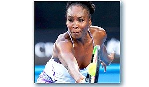 Venus Williams hits a backhand to her sister, Serena, during the women's singles final at the Australian Open tennis championships in Melbourne, Australia, Jan. 28.