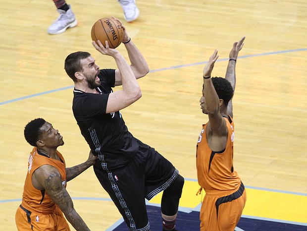 Marc Gasol leans in for two of his 28 points against the Phoenix Suns Tuesday night. The Grizzlies won 130-112.