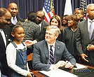 Gov. Charlie Baker signs an authorization creating a Black Advisory Commission.