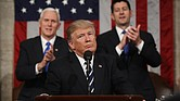 President Donald Trump flanked by Vice President Mike Pence and Speaker of the House Paul Ryan. (JIM LO SCALZO/AFP/Getty Images via The Root)